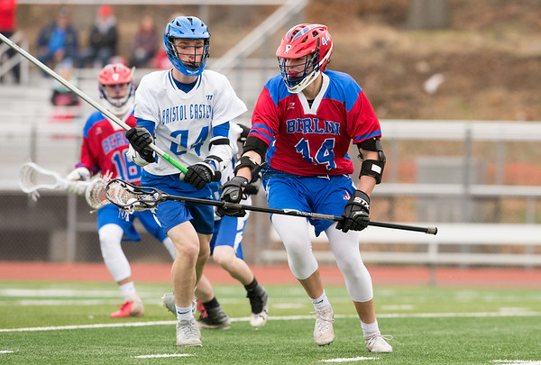 04/18/19 Wesley Bunnell | Staff Berlin boys lacrosse defeated Bristol Eastern at on Thursday afternoon at Bristol Eastern High School. Berlin's Trevor Miano (44) and Eastern's Jack Stavens (24).
