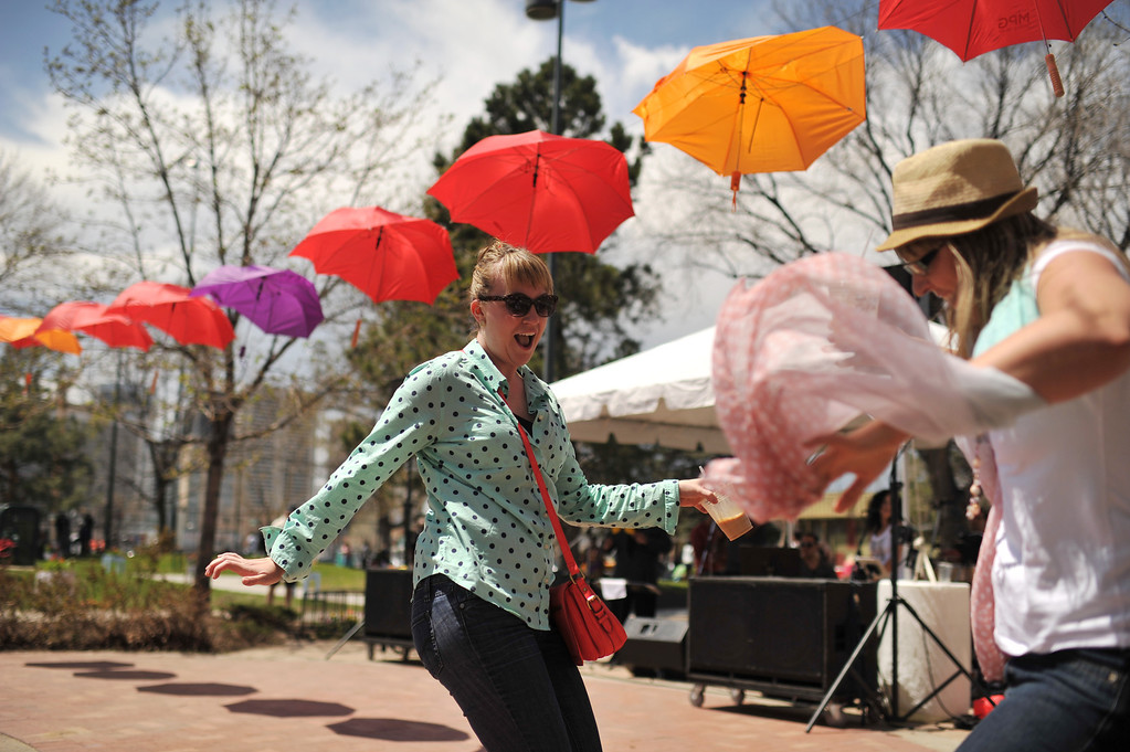 . DENVER, CO. - MAY 11 : Rebecca Powers, left, and Nora Fabris dance during the Five Points Better Block Project at Sonny Lawson Park. Denver, Colorado. May 11, 2013. People are celebrating the Five Points Better Block Project at Sonny Lawson Park. The event was an opportunity for The Five Points Better Block Project to demonstrate potential improvements for the neighborhood and provide tips to promote a stronger community. (Photo By Hyoung Chang/The Denver Post)