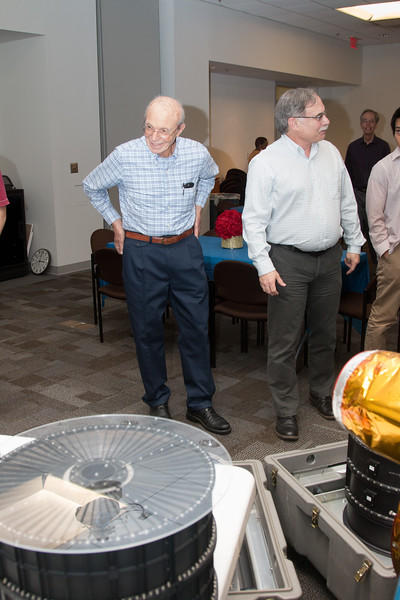 Peter (with Rob Petre) admires the display of X-ray mirrors -- Retirement party for Peter Serlemitsos from NASA/GSFC after 55 years. -- April 27, 2017 -- NASA/Goddard Space Flight Center, Greenbelt, MD
