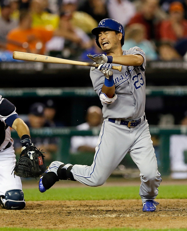 . Kansas City Royals\' Norichika Aoki reacts after being hit by a pitch from Detroit Tigers starting pitcher Rick Porcello during the seventh inning of a baseball game in Detroit, Wednesday, Sept. 10, 2014. (AP Photo/Carlos Osorio)