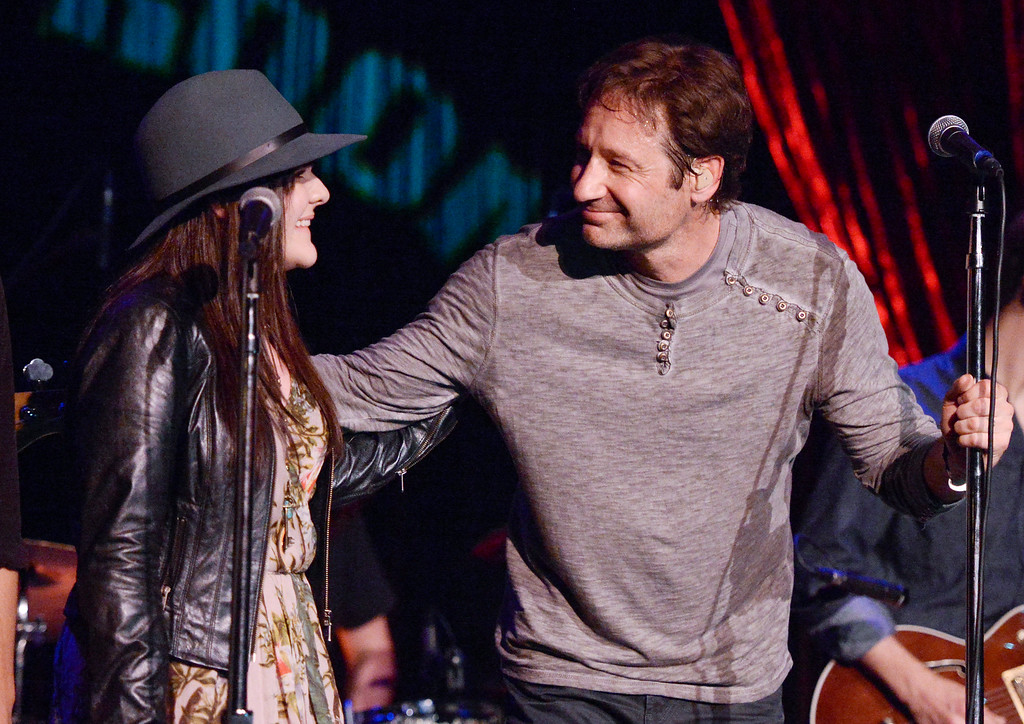 """. David Duchovny is joined by \""""Californication\"""" co-star Madeleine Martin during his performance at The Cutting Room to promote the release of his debut album \""""Hell Or Highwater\"""", on Tuesday, May 12, 2015, in New York. (Photo by Evan Agostini/Invision/AP)"""