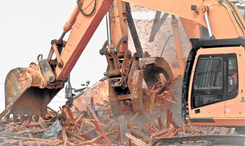 Sensitive deconstruction - not insensitive demolition - of an historic building containing unique Oregon timbers