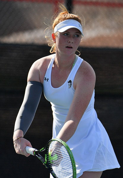 LAS VEGAS, NV - JANUARY 20:  Rebecca Keijzerwaard of the New Mexico State Aggies serves during her match against Pei-Hsuan (Patty) Kuo of the Weber State Wildcats at the Frank and Vicki Fertitta Tennis Complex in Las Vegas, Nevada. Kuo won the match 6-3, 7-6 (10-5),