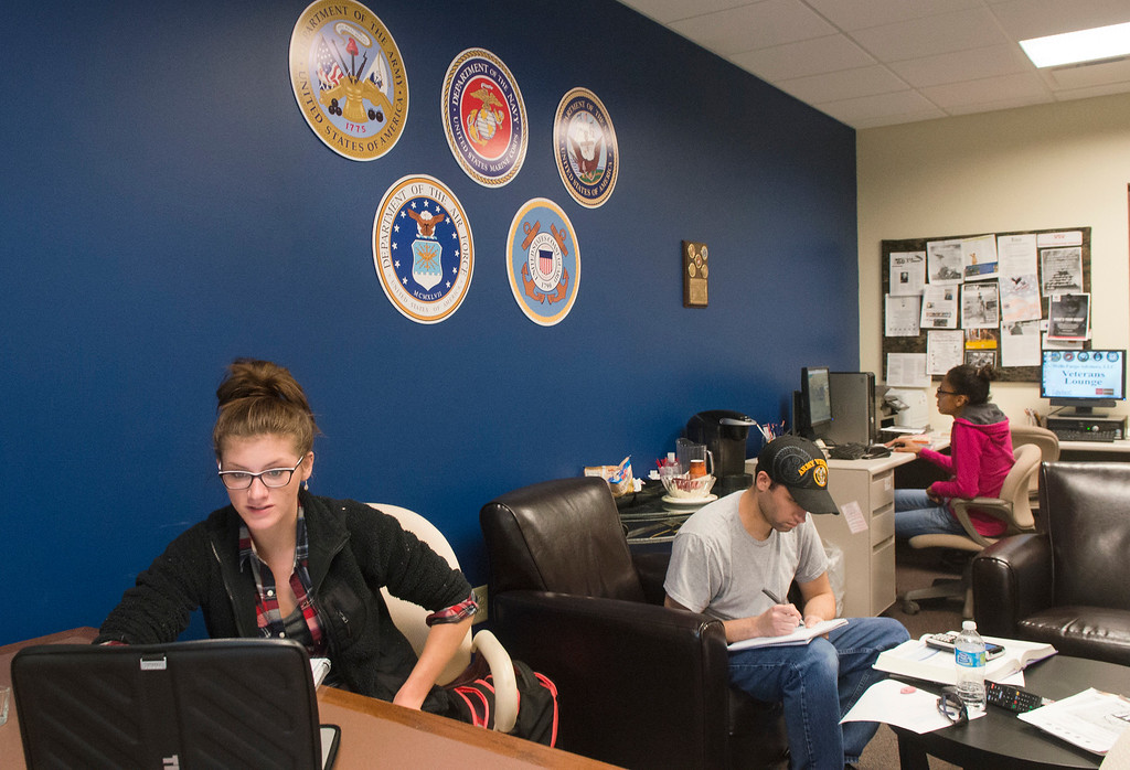 . From left, Katherine Lutes, Steven Covert and Luciana Noce study in the  Veterans Lounge on Oct. 9, 2014, at Lakeland Community College.  (News-Herald file)