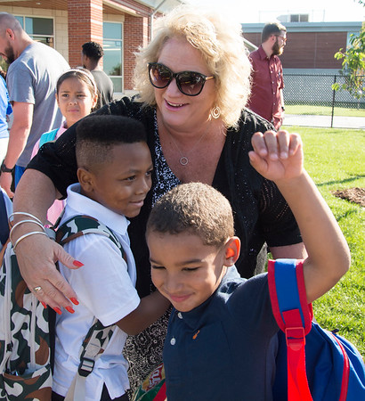 09/03/19 Wesley Bunnell | StaffrrSmalley School Principal Andrea Foligno hugs one of several students during the first day back at school on Tuesday September 3, 2019.