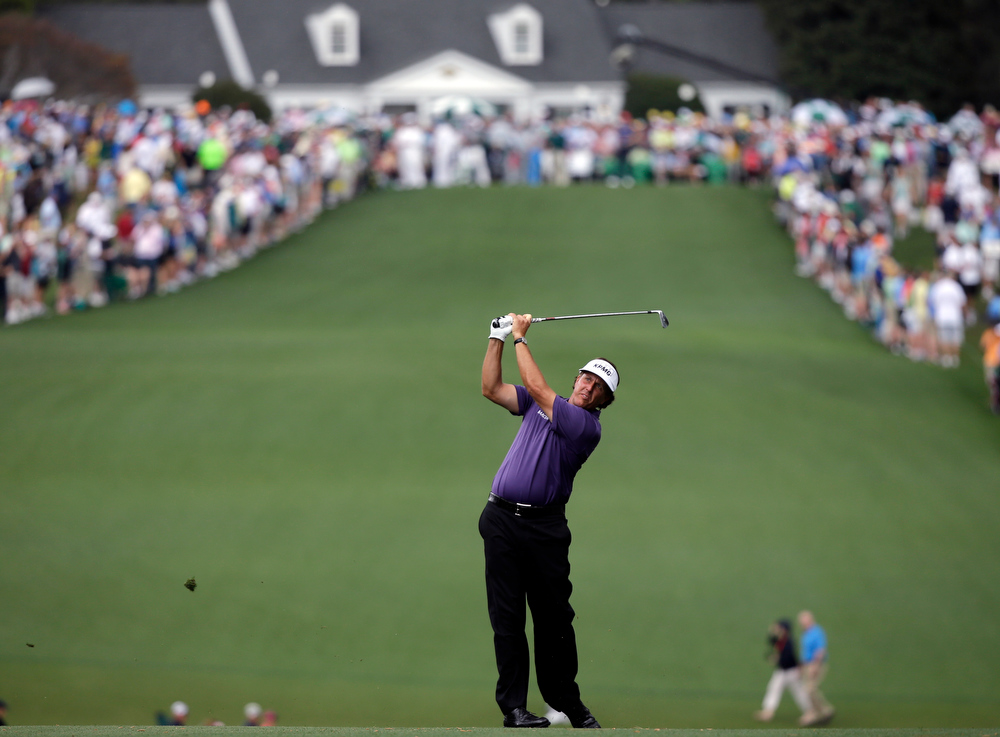 Description of . Phil Mickelson hits off the first fairway during the second round of the Masters golf tournament Friday, April 12, 2013, in Augusta, Ga. (AP Photo/David J. Phillip)