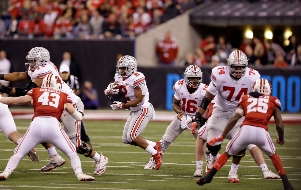 . Ohio State running back J.K. Dobbins runs with the ball during the second half of the Big Ten championship NCAA college football game against Wisconsin, Saturday, Dec. 2, 2017, in Indianapolis. (AP Photo/AJ Mast)