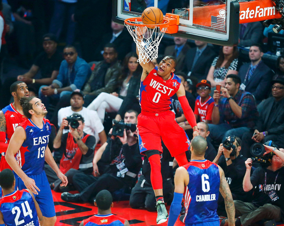 . NBA All-Star Russell Westbrook of the Oklahoma Thunder (0) dunks during the 2013 NBA All-Star basketball game in Houston, Texas, February 17, 2013. REUTERS/Jeff Haynes
