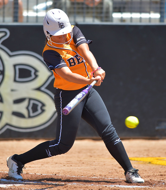 . LBSU\'s Darian Tautalafua connects for a single as LBSU lost to Cal Poly softball 3-0 in Long Beach, CA on Sunday, May 4, 2014.  (Photo by Scott Varley, Daily Breeze)