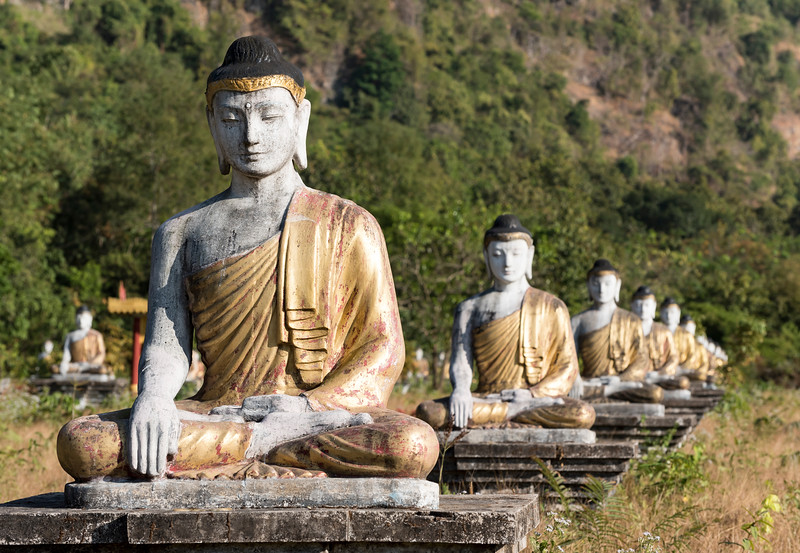 Buddha statues lined up in rows at the foot of Mt Zwegabin, Hpa-an, Karen (Kayin) State, Burma