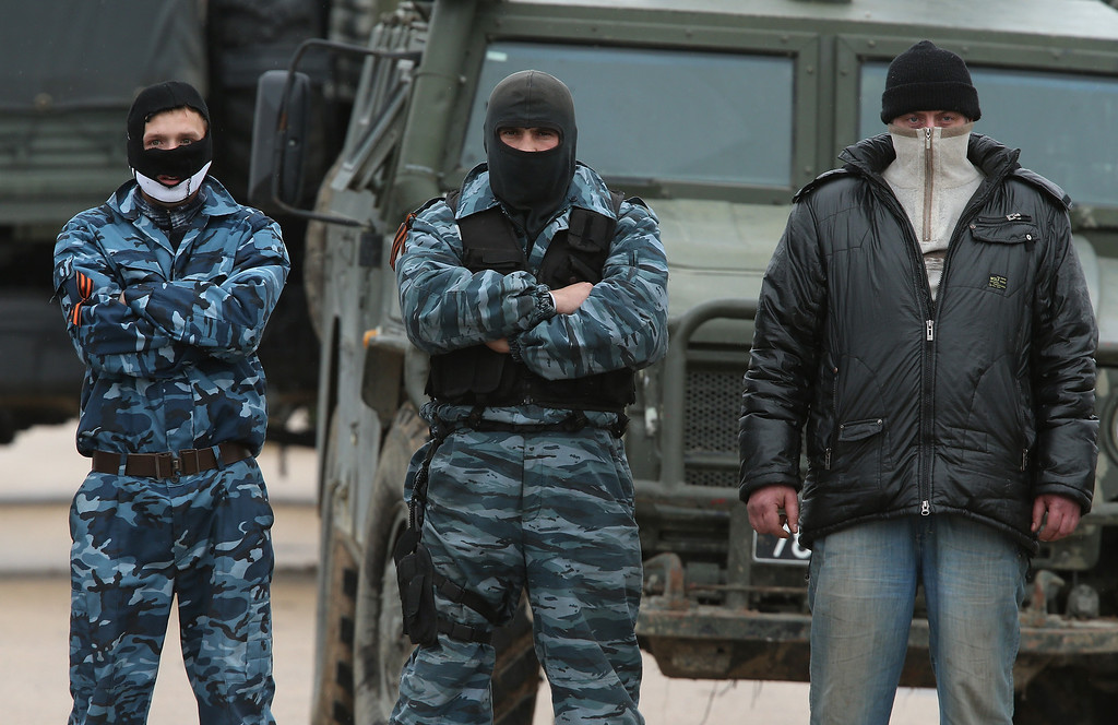 . A line of pro-Russian militants guard the Russian occupied Belbek airbase as Russian-led troops blockade a number of Ukrainian military bases across Crimea, on March 4, 2014 in Lubimovka, Ukraine.   (Photo by Sean Gallup/Getty Images)