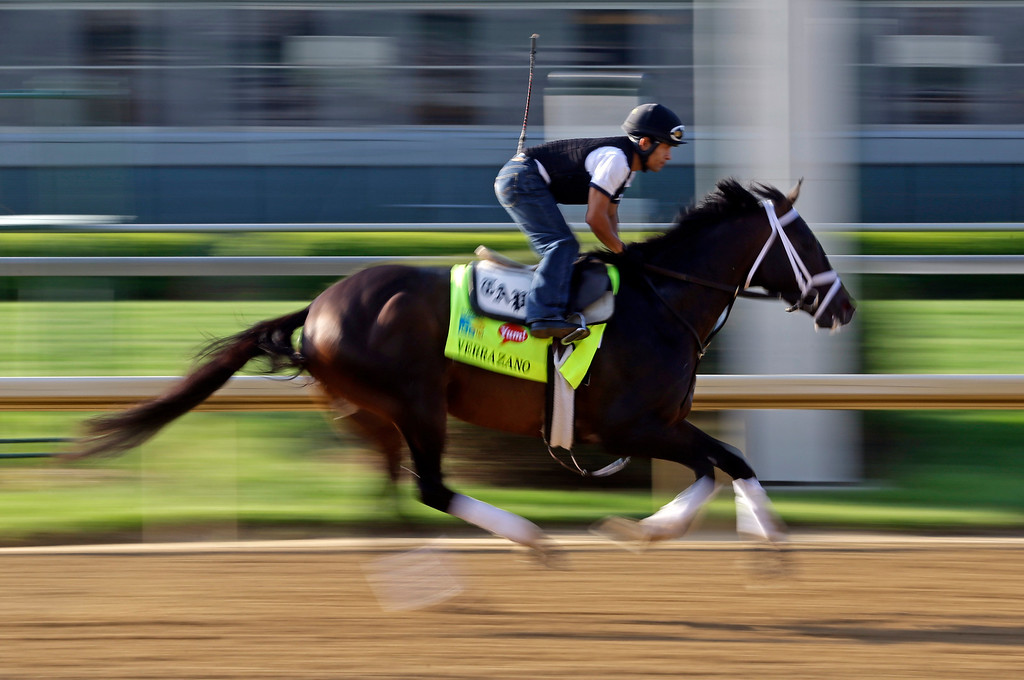 . Exercise rider Humberto Zamora rides Kentucky Derby hopeful Verrazano for a workout at Churchill Downs Wednesday, May 1, 2013, in Louisville, Ky. (AP Photo/Morry Gash)