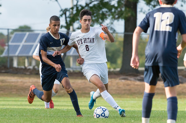 09/24/19 Wesley Bunnell | StaffrrNewington boys soccer defeated New Britain 3-1 on Tuesday afternoon at Newington High School. Newington's Youseff Khadrani (17) chases New Britain's John Morell (8).