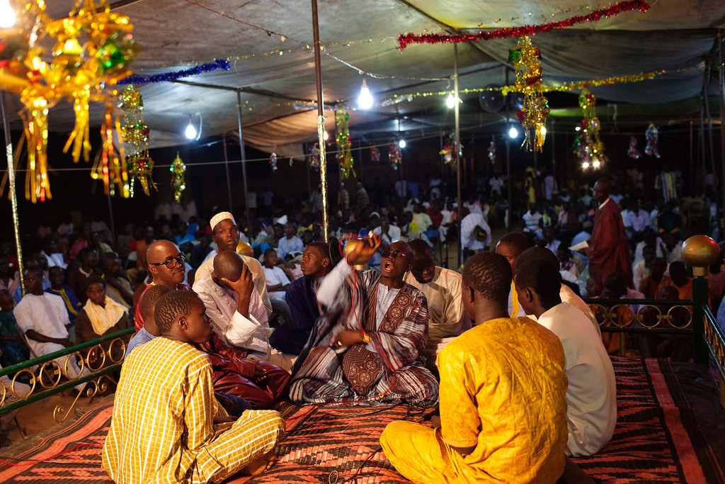 . People from the Mouride sect of Sufi Islam chant prayers in the village of Ndande, May 18, 2013. Every year, inhabitants of the village take part in a Sufi Muslim ceremony called Gamou-Ndande. The ceremony combines nights of praying and chanting as well as traditionally animist ceremonies. Picture taken May 18, 2013. REUTERS/Joe Penney