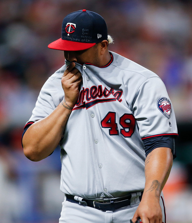 . Minnesota Twins starting pitcher Adalberto Mejia walks off the field after being pulled after hitting Cleveland Indians\' Yan Gomes with a pitch with the bases loaded during the fourth inning in a baseball game, Wednesday, Sept. 27, 2017, in Cleveland. (AP Photo/Ron Schwane)