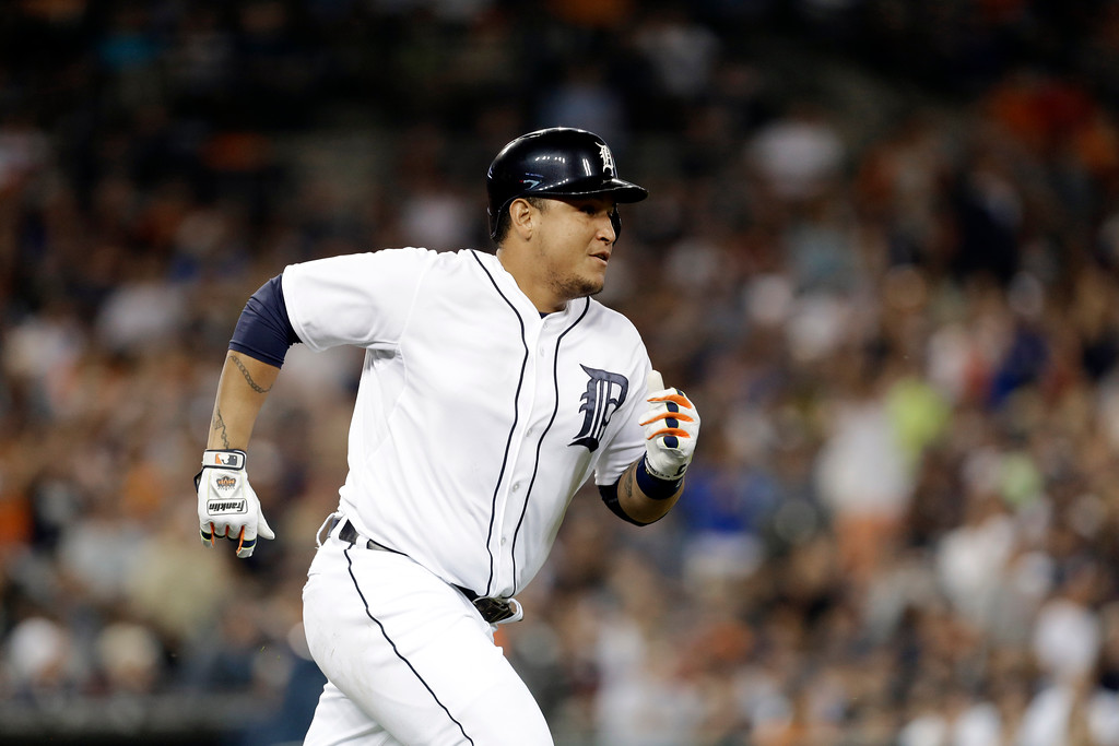 . Detroit Tigers\' Miguel Cabrera doubles against the New York Yankees in the third inning of a baseball game in Detroit Tuesday, Aug. 26, 2014. (AP Photo/Paul Sancya)