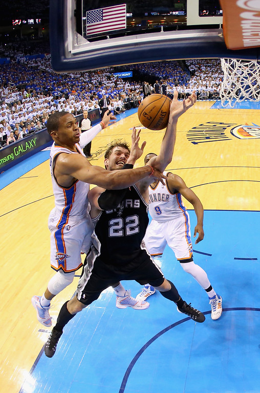 . OKLAHOMA CITY, OK - MAY 27: Russell Westbrook #0 of the Oklahoma City Thunder defends Tiago Splitter #22 of the San Antonio Spurs in the second half during Game Four of the Western Conference Finals of the 2014 NBA Playoffs at Chesapeake Energy Arena on May 27, 2014 in Oklahoma City, Oklahoma. (Photo by Ronald Martinez/Getty Images)