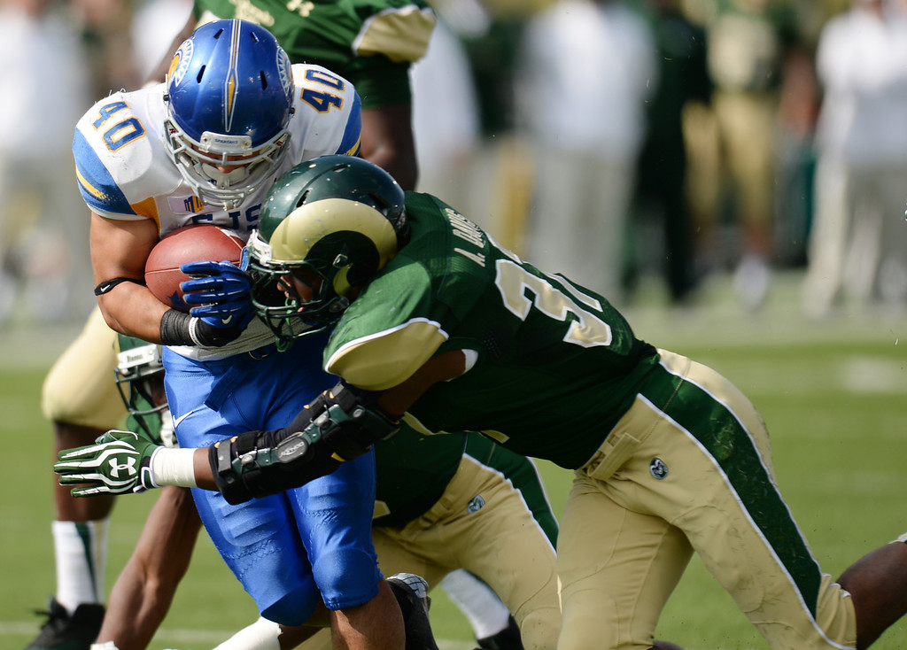. FORT COLLINS, CO - OCTOBER 12 : Aaron Davis of Colorado State (37), right, tackles Jarrod Lawson of San Jose State (40) in the 1st quarter of the game at Hughes Stadium. Fort Collins. Colorado. October 12, 2013. San Jose won 34-27. (Photo by Hyoung Chang/The Denver Post)
