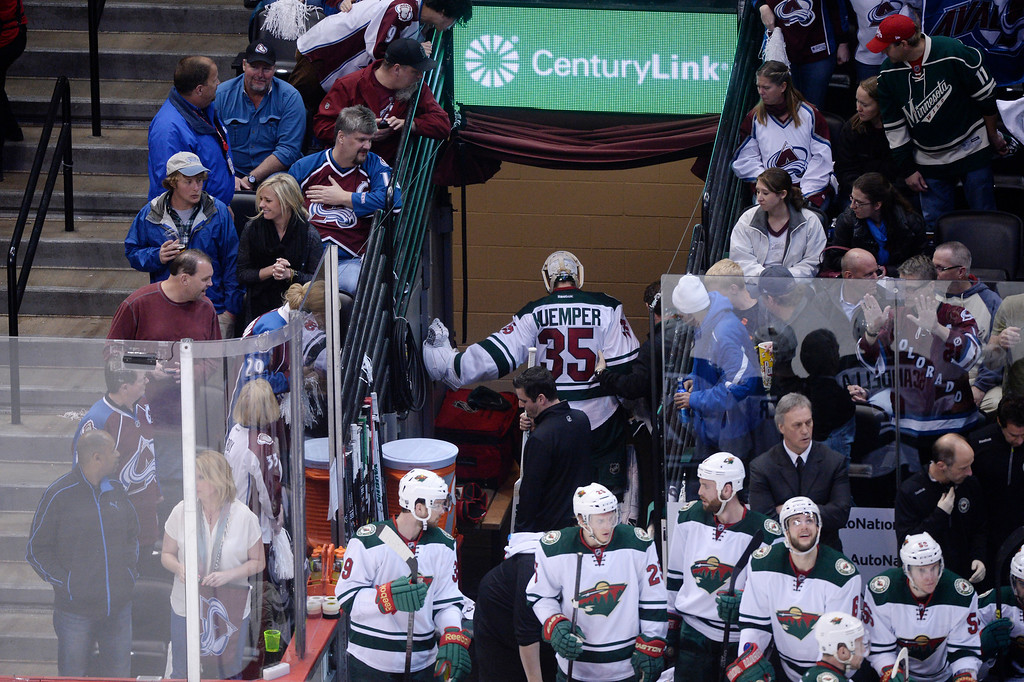 . Darcy Kuemper (35) of the Minnesota Wild leaves the ice during the third period. (Photo by Karl Gehring/The Denver Post)