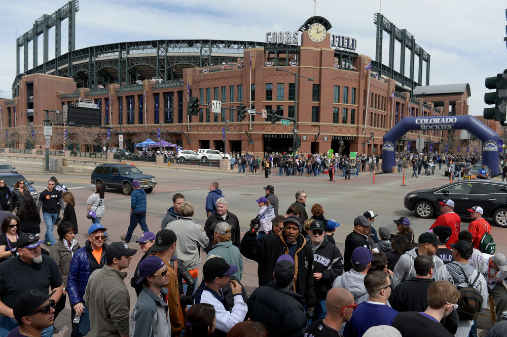 . Fans head into the stadium before the game. The Colorado Rockies hosted the Arizona Diamondbacks in the Rockies season home opener at Coors Field in Denver, Colorado Friday, April 4, 2014. (Photo by Craig F. Walker/The Denver Post)