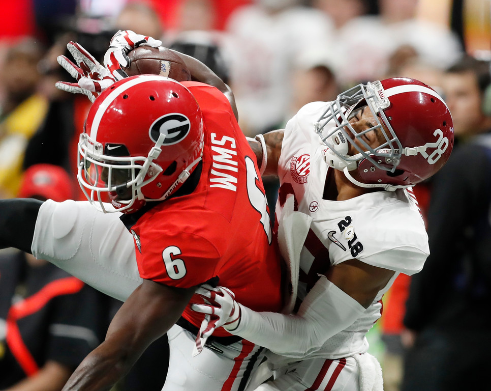 . Georgia wide receiver Javon Wims catches a pass in front of Alabama\'s Anthony Averett during the first half of the NCAA college football playoff championship game Monday, Jan. 8, 2018, in Atlanta. (AP Photo/David Goldman)