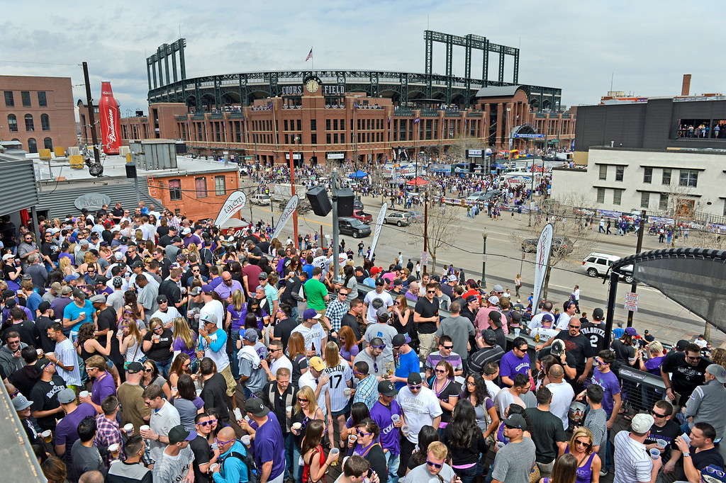 . Fans gather on the roof of Tavern Downtown on Market Street before the start of the game.  (Photo by Andy Cross/The Denver Post)
