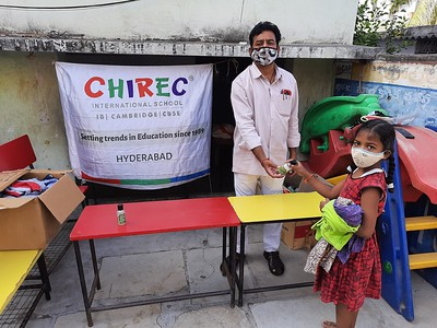 Donation of Sanitizers, Face Masks and Clothes in Jeedimetla