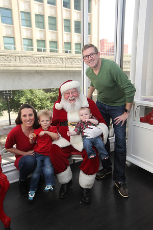 Hudson and Grayson with Santa at Sweet Pete's Candy Shop