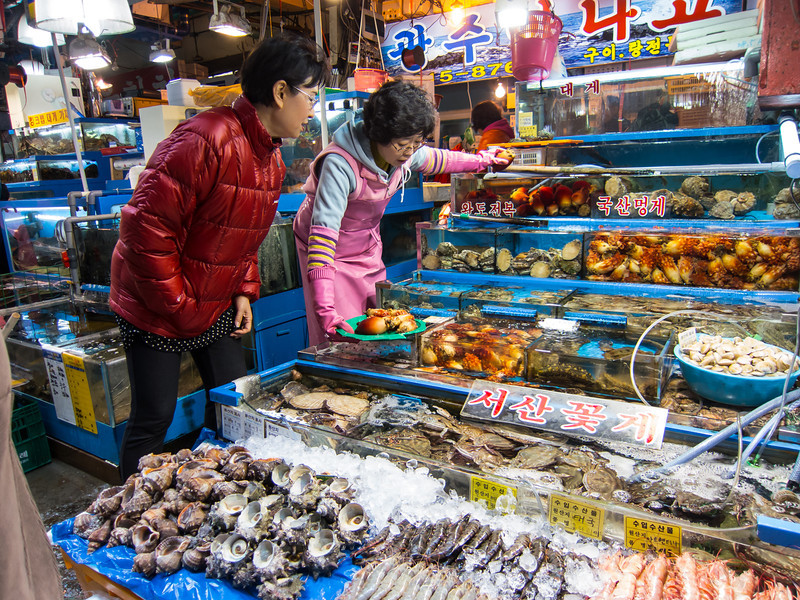Buying fish  and sea squirt (?) at Noryangjin Fish Market in Seoul.