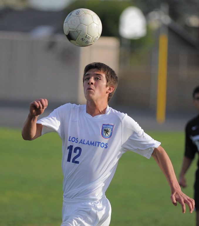 . 02-15-2012--(LANG Staff Photo by Sean Hiller)- Los Alamitos beat Buena 4-1 in the first round of the Division 1 boys soccer playoffs Friday at Laurel School in Los Alamitos. Daniel Weis heads the ball for Los Alamitos.