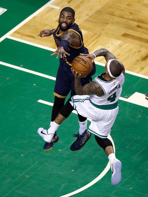 . Cleveland Cavaliers guard Kyrie Irving (2) tries to block Boston Celtics guard Isaiah Thomas (4) during an NBA basketball game in Boston, Wednesday, March 1, 2017. (AP Photo/Charles Krupa)