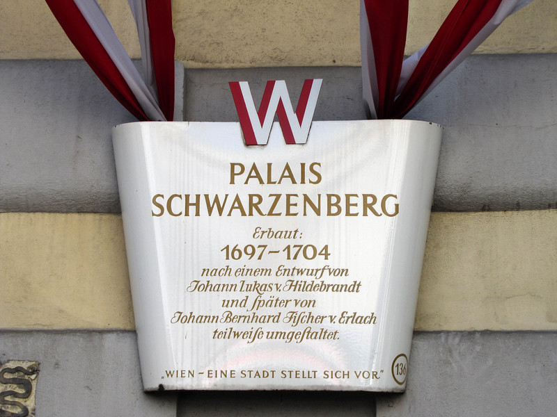 "16-Schwarzenberg Platz is the location of the Red Army Liberation Monument and the high-jet fountain. The bottom line of the placard reads: ""Vienna–A city introduces itself."""