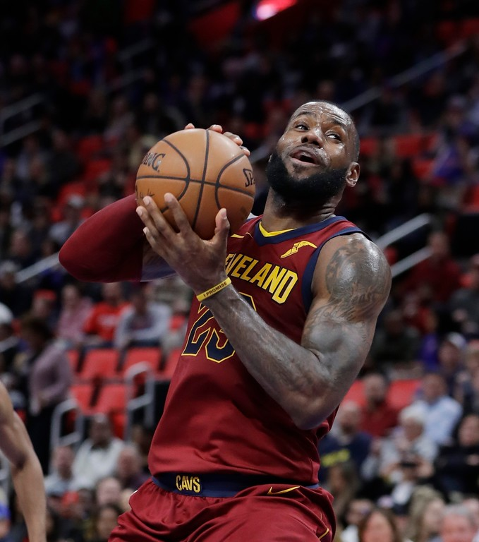. Cleveland Cavaliers forward LeBron James prepares to shoot during the second half of an NBA basketball game against the Detroit Pistons, Monday, Nov. 20, 2017, in Detroit. (AP Photo/Carlos Osorio)