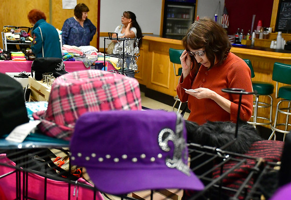 4/13/2019 Mike Orazzi | Staff Karyn Ahern shops for items during the Bristol Swedish Social Club's Spring Craft & Vendor Show on Saturday at the club in Bristol.