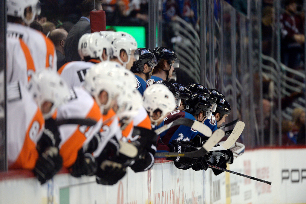 . Colorado Avalanche and the Philadelphia Flyers lean over to watch during the third period January 2, 2014 at Pepsi Center. (Photo by John Leyba/The Denver Post)
