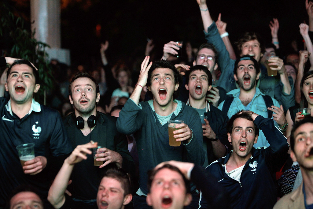 . French soccer fans react as they watch a live broadcast of the group E World Cup soccer match between Ecuador and France, in central Paris, France, Wednesday, June 25, 2014. (AP Photo/Thibault Camus)