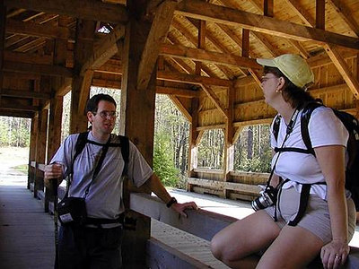 Jack explains things to Dee  on the covered bridge above High Falls in Dupont State Forest NC