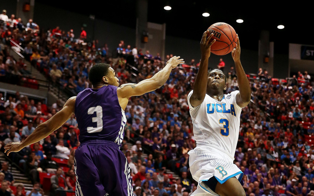 . Jordan Adams #3 of the UCLA Bruins shoots against Deshaunt Walker #3 of the Stephen F. Austin Lumberjacks in the second half during the third round of the 2014 NCAA Men\'s Basketball Tournament at Viejas Arena on March 23, 2014 in San Diego, California.  (Photo by Jeff Gross/Getty Images)