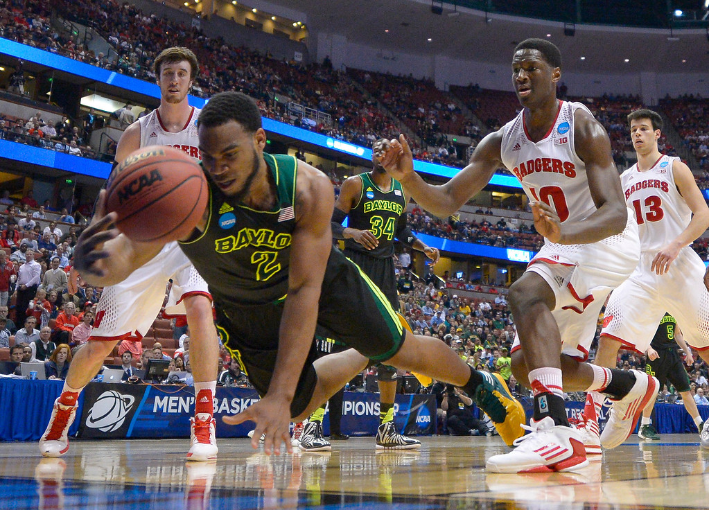 . Baylor forward Rico Gathers (2) dives for a loose ball during the first half against Wisconsin in an NCAA men\'s college basketball tournament regional semifinal, Thursday, March 27, 2014, in Anaheim, Calif. (AP Photo/Mark J. Terrill)