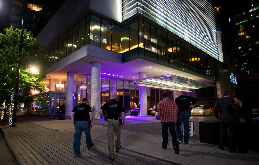 . Police officers enter the Fairmont Pacific Rim Hotel where Canadian actor Corey Monteith was found dead in his room earlier in the day in Vancouver, British Columbia. Monteith was found dead in his hotel room, police said. He was 31. (AP Photo/The Canadian Press, Darryl Dyck)