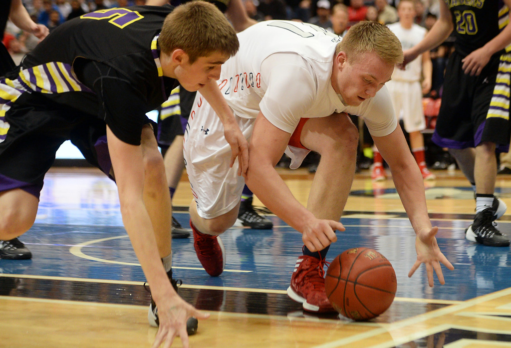 . Raiders senior guard Michael Hannon, left, and St. Francis junior center Blake Moreno scramble after a loose ball during the first half. (Pioneer Press: John Autey)