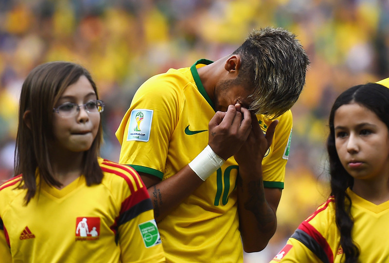 . Neymar of Brazil reacts during the National Anthem prior to the 2014 FIFA World Cup Brazil Group A match between Brazil and Mexico at Castelao on June 17, 2014 in Fortaleza, Brazil.  (Photo by Buda Mendes/Getty Images)