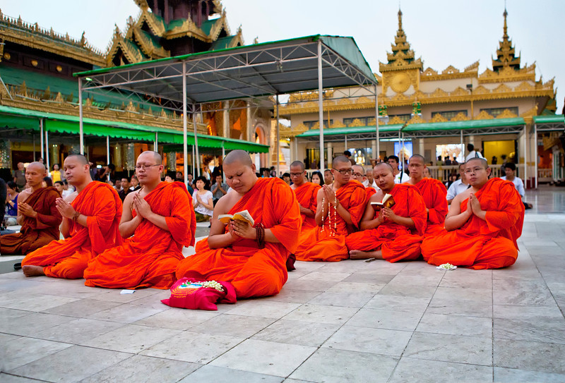 Monks Praying at the End of the Day at Shwedagon Pagoda. Yangon.