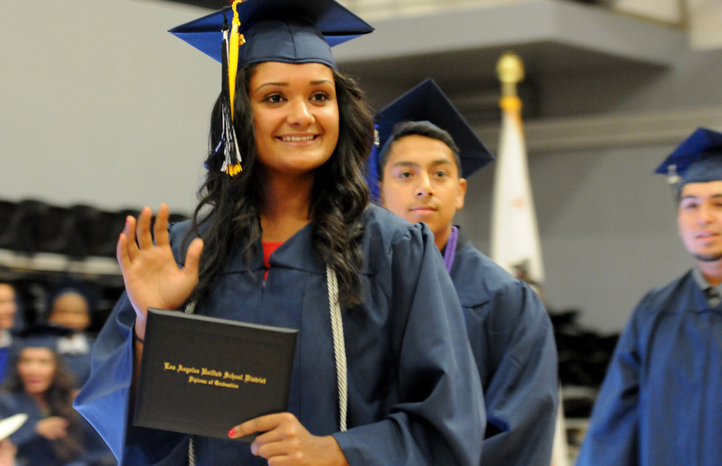 . A student waves after getting her diploma at the Northridge Academy High School graduation ceremony on Thursday, June 5, 2014. (Photo by Dean Musgrove/Los Angeles Daily News)