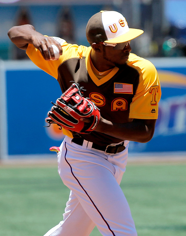 . U.S Team\'s Travis Demeritte, of the Texas Rangers, warms up prior to the All-Star Futures baseball game against the World team, Sunday, July 10, 2016, in San Diego. (AP Photo/Lenny Ignelzi)
