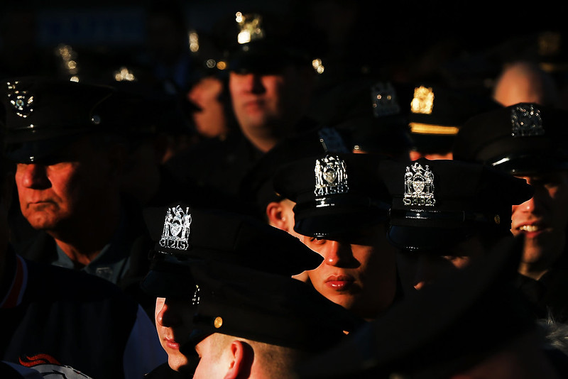 . Police officers from around the country gather outside of  Christ Tabernacle Church for the funeral of slain New York City Police Officer Rafael Ramos, one of two officers murdered while sitting in their patrol car in an ambush in Brooklyn last Saturday afternoon on December 27, 2014 in New York City. Thousands of fellow officers, family, friends and Vice President Joseph Biden are expected at the church in the Glendale neighborhood of Queens for the funeral.  (Photo by Spencer Platt/Getty Images)