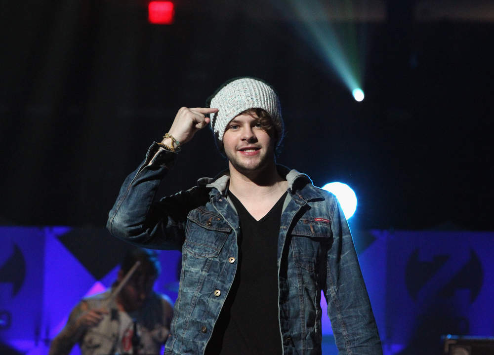 Description of . Jay McGuiness of The Wanted performs onstage during Z100's Jingle Ball 2012, presented by Aeropostale, at Madison Square Garden on December 7, 2012 in New York City.  (Photo by Kevin Kane/Getty Images for Jingle Ball 2012)