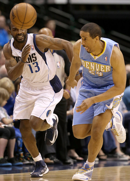 . Denver Nuggets point guard Andre Miller (24) and Dallas Mavericks point guard Mike James (13) chase the loose ball during the first half of an NBA basketball game on Friday, April 12, 2013, in Dallas. (AP Photo/LM Otero)