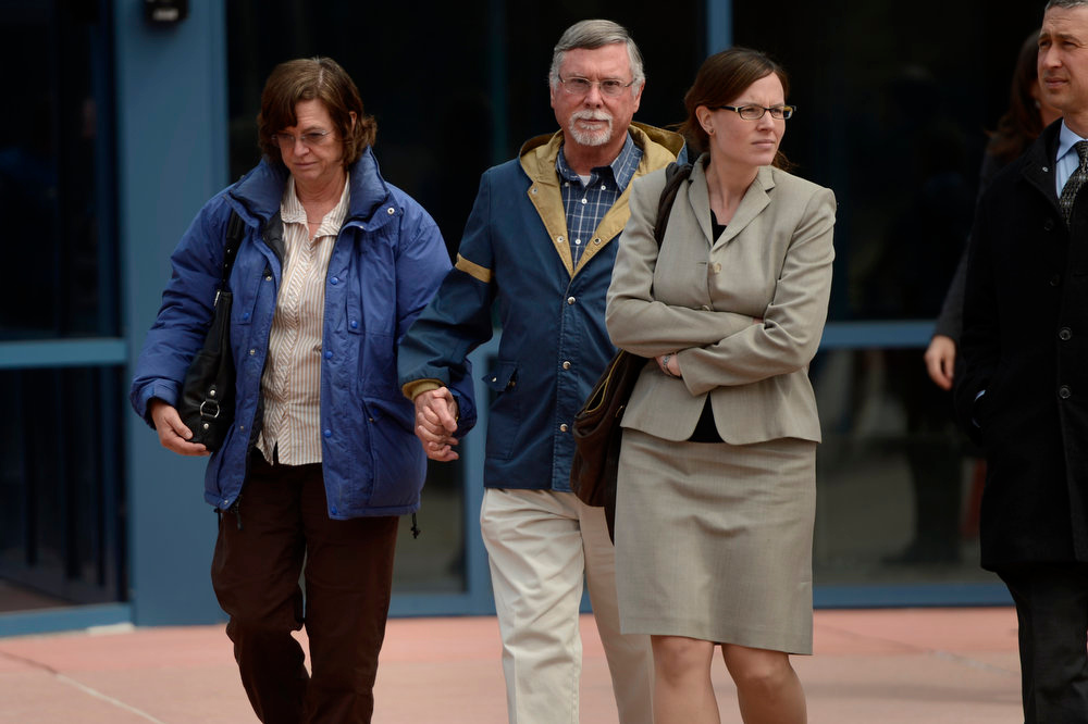 Description of . Arlene and Robert Holmes, parents of Aurora theater shooting suspect James Holmes, leaving the Arapahoe County Justice Center April 01, 2013 Centennial, Colorado. (Photo By Joe Amon/The Denver Post)