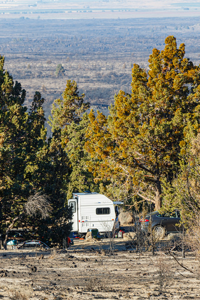 A small camper trailer and tent at the Indian Wells campground in lava beds national monument - Lava Beds Campground Road, Tulelake, California, United States (US)